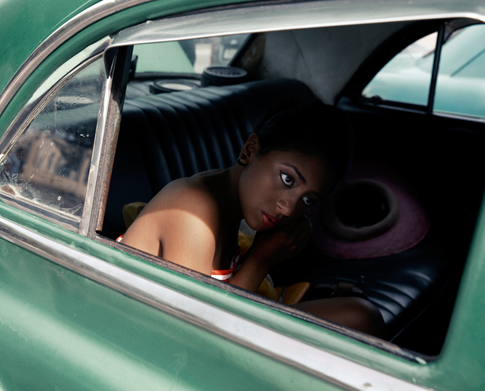 A young girl is getting ready for her Quinceañera party,a celebration of the girl's fifteenth birthday and an importantcustomin Latin America. These celebrations are recently becoming more and more popularamong Havana'sresidents