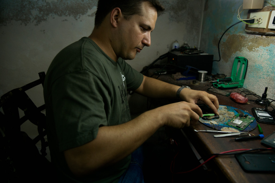 """Lately, business are booming!"", said  Omer Gosman (31), a communications technician and the only smart phones technician of his town, Sancti Spiritus."